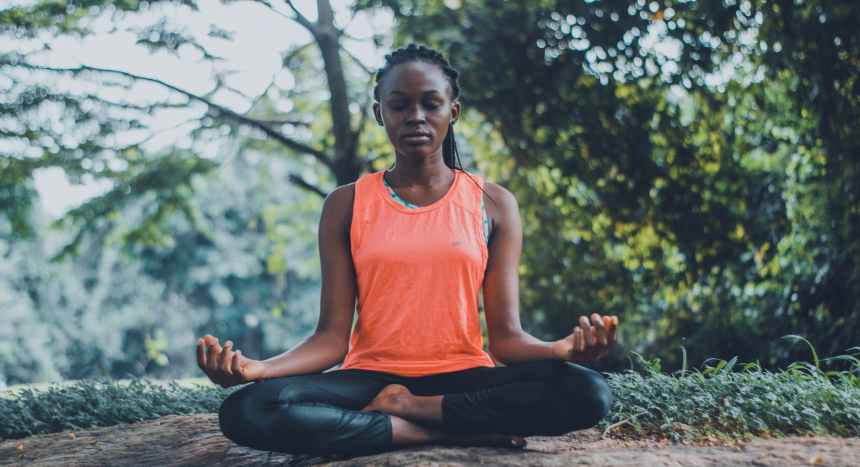 woman meditating in the outdoors